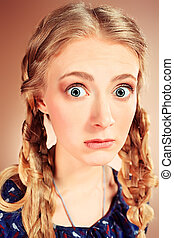 amazement - Portrait of a funny pretty blonde girl posing at...