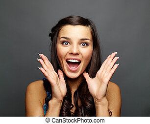 Amazement - Portrait of astonished brunette looking at ...