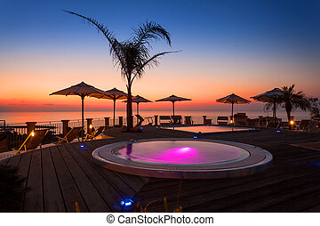 Amazin sunset view from hotel spa area with creative pools