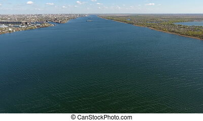 Amazing aerial shot of the sparkling blue waters of the Dnipro in early spring