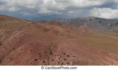 Amazing aerial video of the textured yellow and red mountains resembling the surface of Mars in Altai mountains
