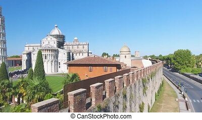 Amazing aerial view of Field of Miracles on a beautiful sunny morning. Tower, Baptistery and Cathedral, Pisa, Tuscany. Slow motion