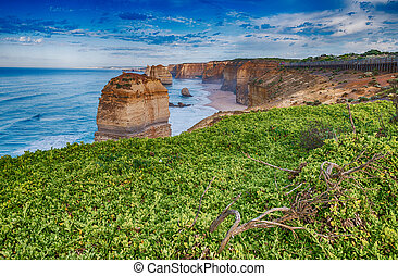 Amazing aerial view of limestone rocks above the ocean, Twelve Apostles, Australia