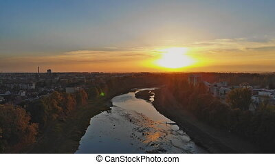 Amazing Aerial View over the Uzhgorod Ukraine over the river during sunset.