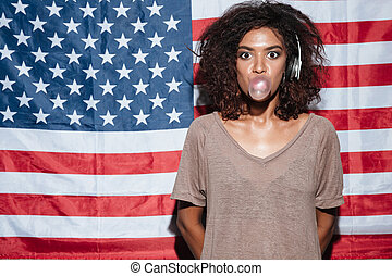 Amazing african young woman with chewing gum