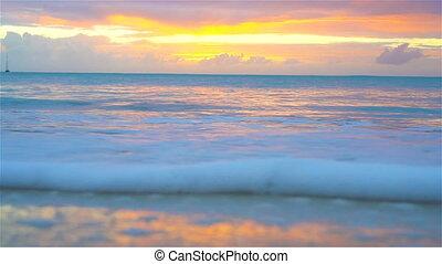 Amazing beautiful sunset on an exotic caribbean beach -...