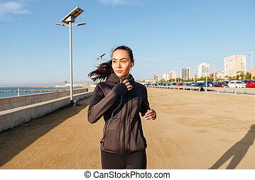 Amazing beautiful young asian sports woman running