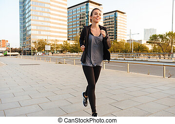 Amazing beautiful young sports woman running
