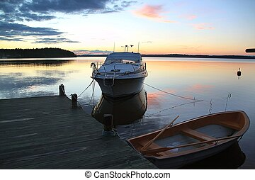 Amazing beauty colorful sunset on the lake in Sweden. Unforgettable view.