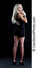 Amazing blond girl in black cloth look at camera