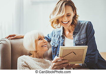 Amazing blonde woman sitting near her grandmother