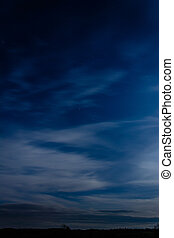 Amazing blue sky over Ukrainian Carpathians, blurred with white clouds