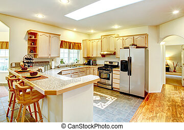 Amazing bright kitchen with maple storage combination -...