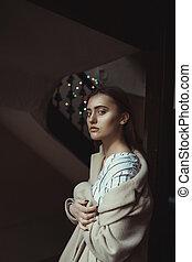 Amazing brunette model posing in the dark room