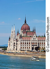 amazing building of Parliament in Budapest and ships in front of