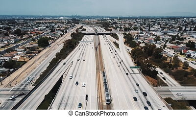 Amazing cinematic aerial shot of busy American interstate...