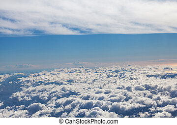Amazing cloudy sky view from airplane window