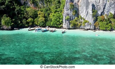 Amazing coastline of Phi Phi Don, Thailand. Aerial view on a beautiful sunny day with crystal clear ocean
