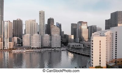 Amazing Downtown Miami aerial skyline from Brickell Key on a sunny morning, Florida in slow motion.