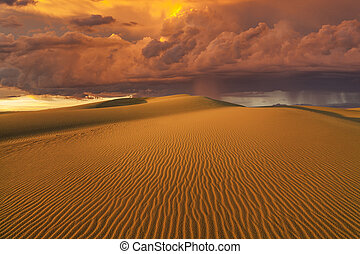 Amazing fiery rain clouds over the Gobi desert. Mongolia.