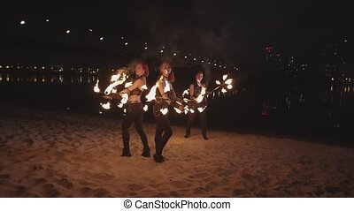 Amazing fireshow stunt with flaming staves outdoors -...