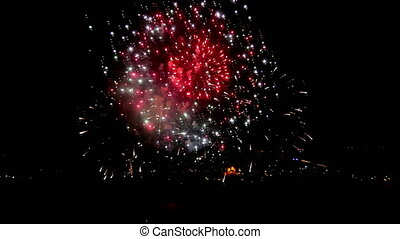 Amazing firework above the city in the night sky with sound....