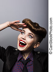 Amazing funny young woman in retro style - trendy hairstyle