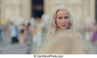 Amazing girl in a blue dress posing in the center of Milan