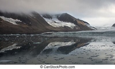 Amazing landscape of mountains on background water of Arctic...