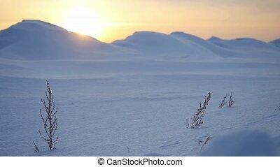 Amazing Landscape of snowy mountain peak on beautiful sunset Adventure Winter Travel in slow motion. 1920x1080