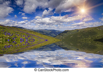 Amazing landscape with mountains, lake and reflection of beautif
