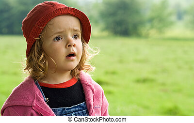 Little girl looking in awe to the wonders of nature - shallow depth of field