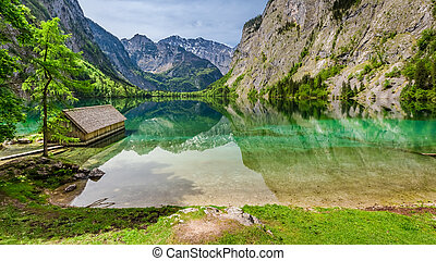 Amazing little house on the lake Obersee in Alps, Europe