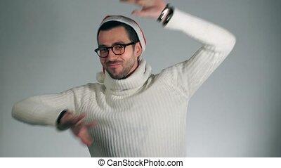 Amazing man in a Santa Claus hat danced crazy dances