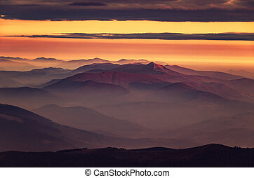 Amazing morning mountain view in pink tonality.