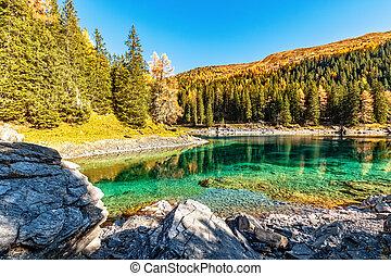 Amazing mountain lake in autumn time. Europe, Austria, Tyrol, Lake Obernberg, Stubai Alps.