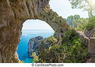 Arco Naturale is natural arch on coast of Capri island, Italy