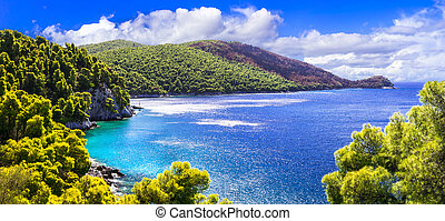 Beautiful Skopelos island, view with turquoise sea and mountains, Greece.