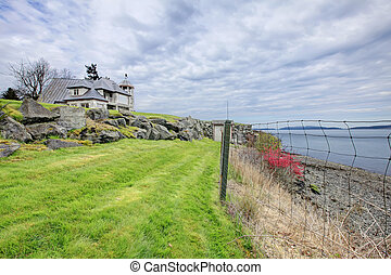Amazing nature view with a stone house on the background