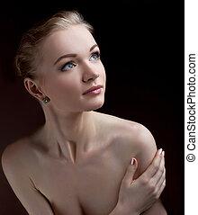 Amazing nude woman studio portrait