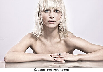 Amazing portrait of beautiful young blonde girl