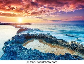 Amazing seaside - Amazing morning sun over the sea. Dramatic...