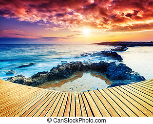 Amazing morning sun over the sea with overcast sky. Black Sea, Crimea, Ukraine, Europe. Beauty world. Retro style filter.