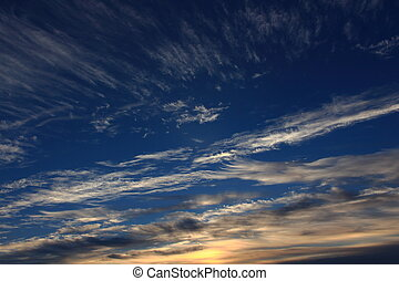 Amazing sky with clouds against the backdrop of dawn