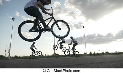 Amazing slow motion with cool teenagers riding on bicyclers...