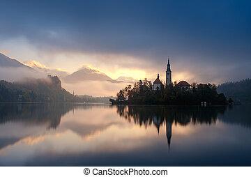 Amazing sunrise at the lake Bled in autumn, Slovenia, Europe