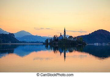 Amazing sunrise at the lake Bled