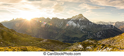 Amazing sunrise in the mountains. Nice lens flares and sunbeams