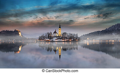 Amazing sunset at the lake Bled in winter, Slovenia. -...