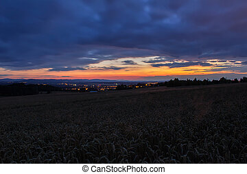 Amazing sunset on field with airport Plana, blue hour, long exposure